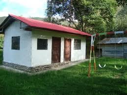 Terreno Comercial en Venta con Casa Sector Bulcay-Planeta Azul Gualaceo - Ecuador